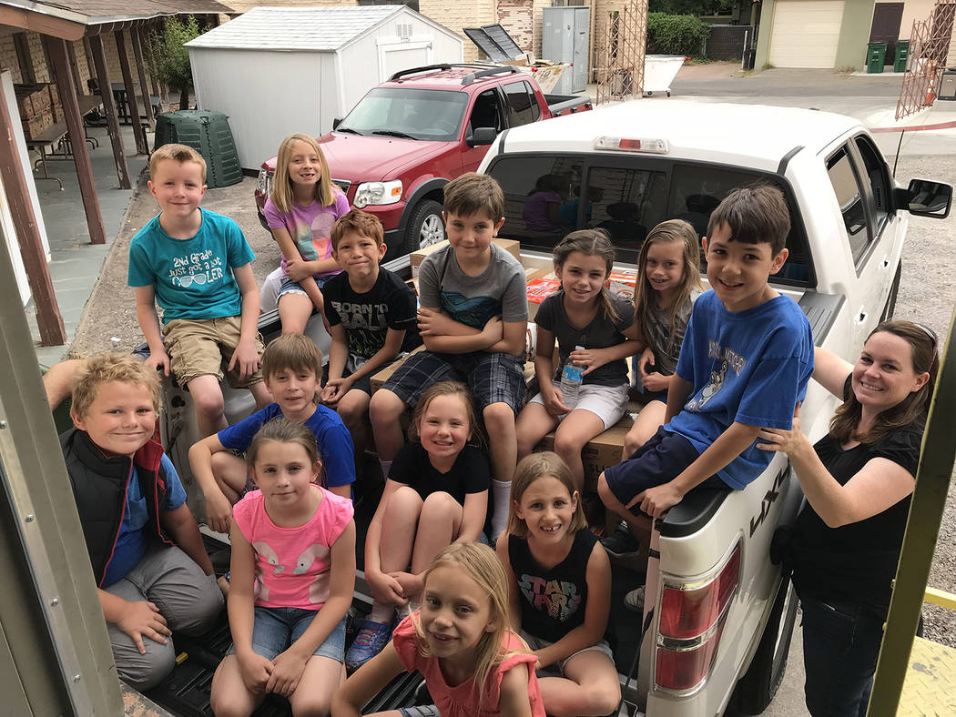 Hali Bernstein Saylor/Boulder City Review Second-graders in Azure Quinlan's class at Mitchell Elementary School collected food to donate to Emergency Aid of Boulder City. On Monday, Quinlan, far r ...