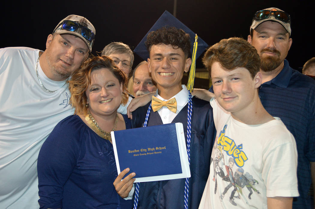 Celia Shortt Goodyear/Boulder City Review One of Boulder City High School's newest graduates, Gabriel Lawrence, center, celebrates with his family, from left, Will Anderson, Valaree Anderson, Nola ...