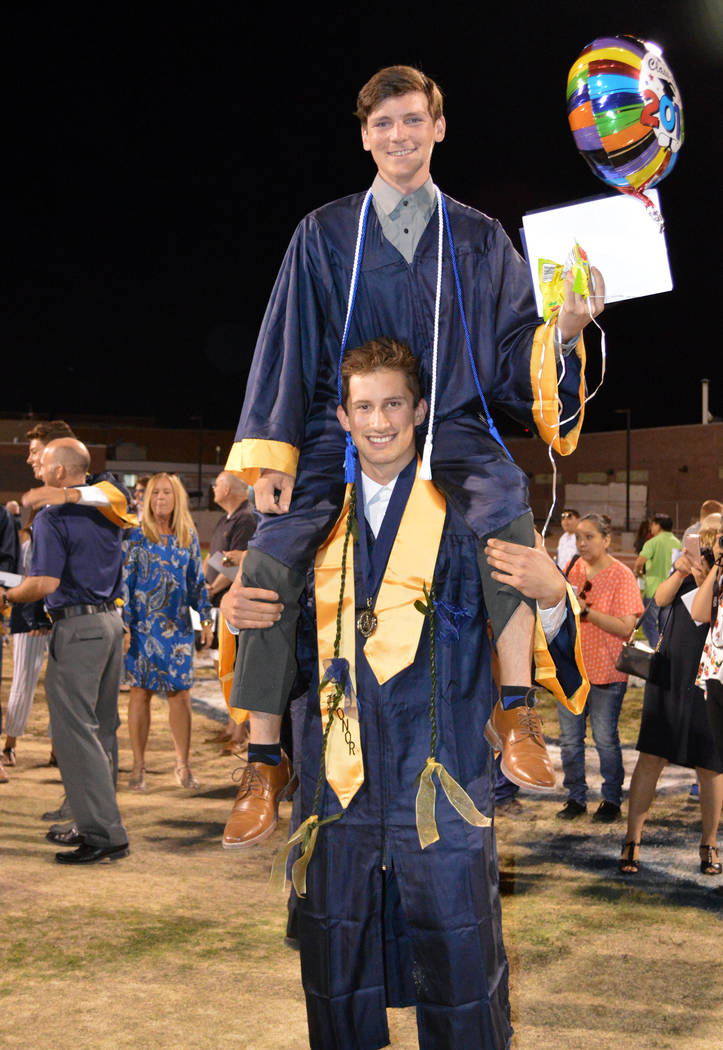 Celia Shortt Goodyear/Boulder City Review Bryce Rogers, top, celebrates graduating from Boulder City High School on Friday with his friend and fellow graduate Sam Oberto.