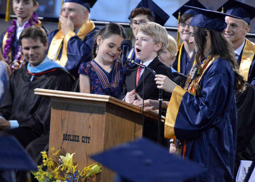 Celia Shortt Goodyear/Boulder City Review Members of the class of 2030 Elizabeth Sargeant and Gary Wentz share some advice with the class of 2018 at the graduation ceremony Friday at Bruce Eaton F ...