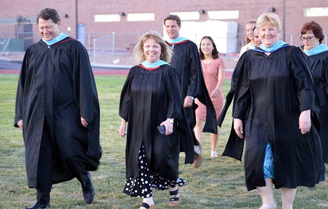 Celia Shortt Goodyear/Boulder City Review Boulder City High School Principal Amy Wagner, center, leads Clark County School District Superintendent Pat Skorkowsky, left, and Garrett Junior High Sch ...