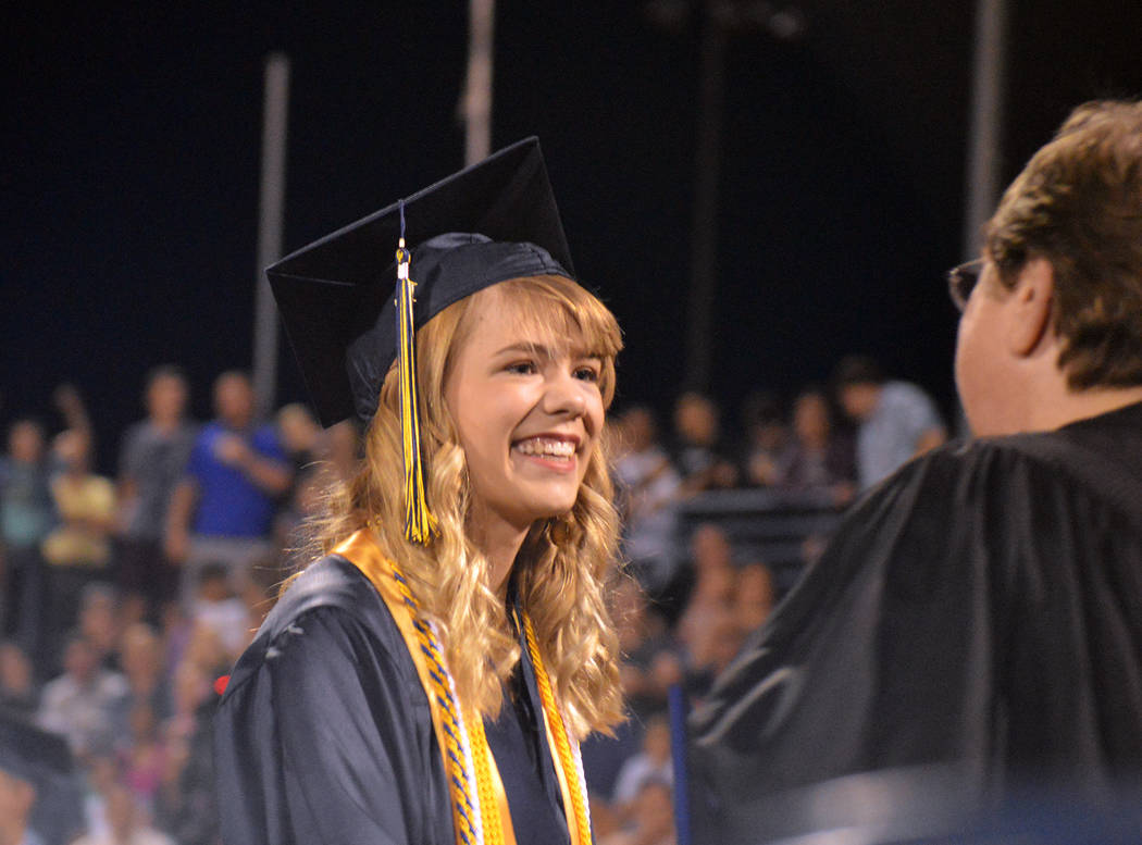 Celia Shortt Goodyear/Boulder City Review Lauren Stewart accepts her diploma Friday at Boulder City High School's 77th annual commencement.