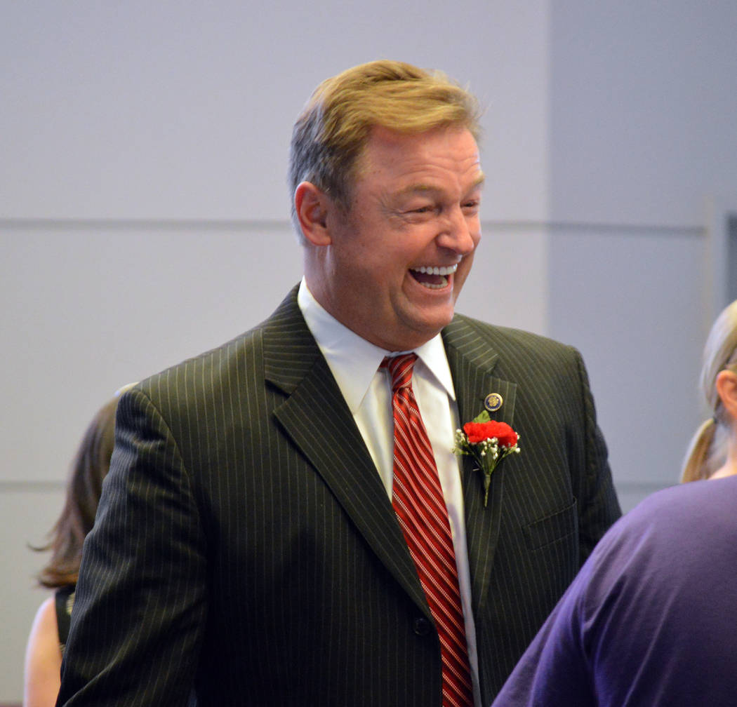 Celia Shortt Goodyear/Boulder City Review U.S. Sen. Dean Heller jokes with a fellow attendee at the Memorial Day ceremony on Monday at the Southern Nevada Veterans Memorial Cemetery in Boulder City.
