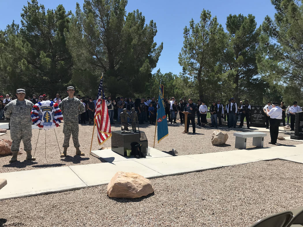 Hali Bernstein Saylor/Boulder City Review Arrow, president of the Vietnam Vets Legacy Vets Motorcycle Club, addresses fellow riders and members of the Special Forces Association, Chapter 51, who c ...