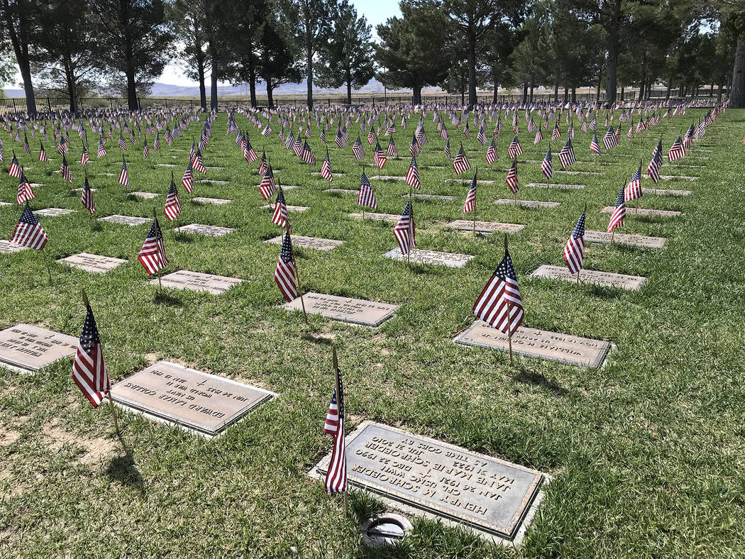 Hali Bernstein Saylor/Boulder City Review American flags were placed at each grave at the Southern Nevada Veterans Memorial Cemetery in Boulder City on Saturday to recognize their service for the ...