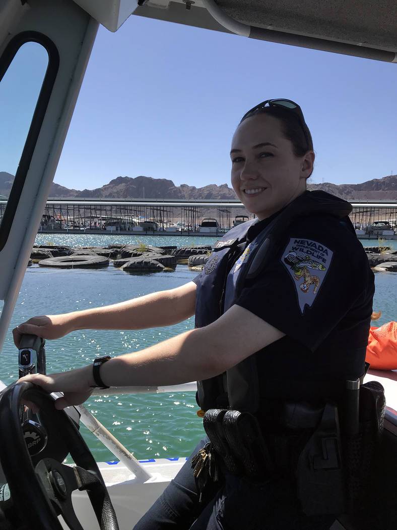 Hali Bernstein Saylor/Boulder City Review Brittany Frolick, a game warden for the Nevada Department of Wildlife, pilots a boat on Lake Mead on Friday while making sure those enjoying recreational ...