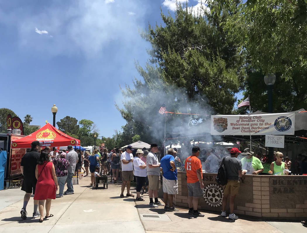 Hali Bernstein Saylor/Boulder City Review The Rotary Club of Boulder City presented the 14th annual Best Dam Barbecue Challenge in Bicentennial Park on Saturday, May 26, 2018. Members of the club ...