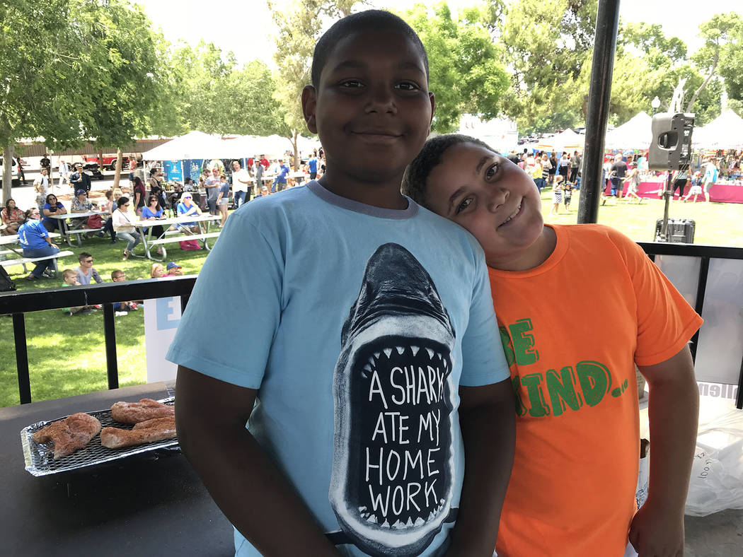 Hali Bernstein Saylor/Boulder City Review Cousins Tyson Blackmore, 10, left, and Messiah Lookner, 8, competed in the KidsQue event that was held as part of the 14th annual Best Dam Barbecue Challe ...