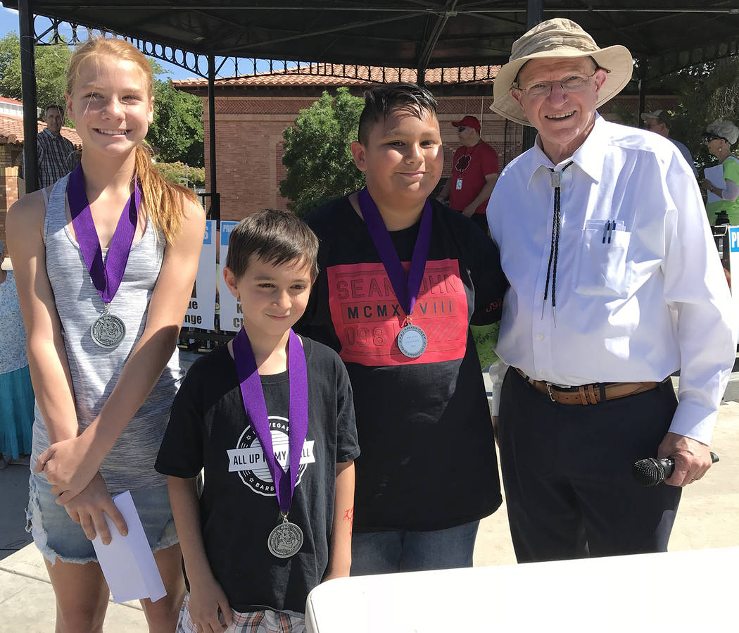 Hali Bernstein Saylor/Boulder City Review Addison Doane, from left, Dean Barr and Sebastian Herandez, winners of the youth division of the KidsQue contest for children 6-12, are congratulated by S ...