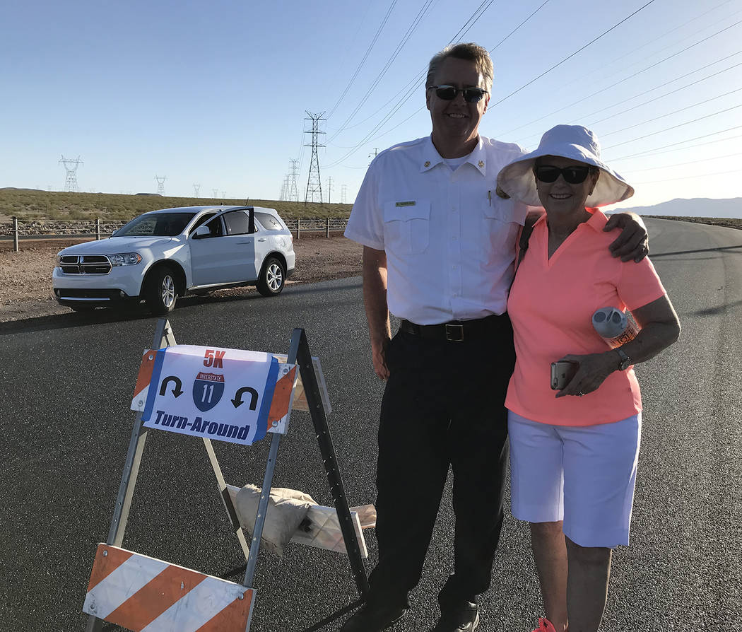 Hali Bernstein Saylor/Boulder City Review Boulder City Fire Chief Kevin Nicholson visits with Councilwoman Peggy Leavitt at the turnaround spot for walkers during Saturday's Boulder City Day on In ...