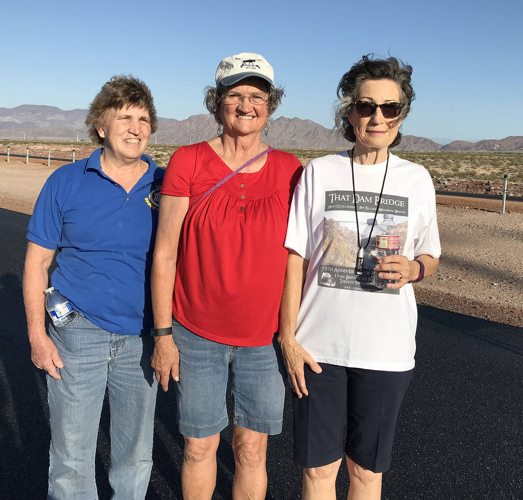 Hali Bernstein Saylor/Boulder City Review Taking advantage of Boulder City Day on Interstate 11 on Saturday to experience the highway before it opens to traffic were, from left, Janet Denning, San ...