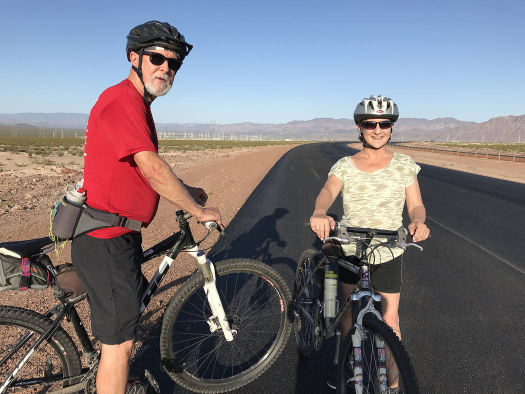 Hali Bernstein Saylor/Boulder City Review Steve and Karen Pinkerton of Boulder City were among the nearly 350 residents who experienced Interstate 11 on Saturday before it opens to traffic.