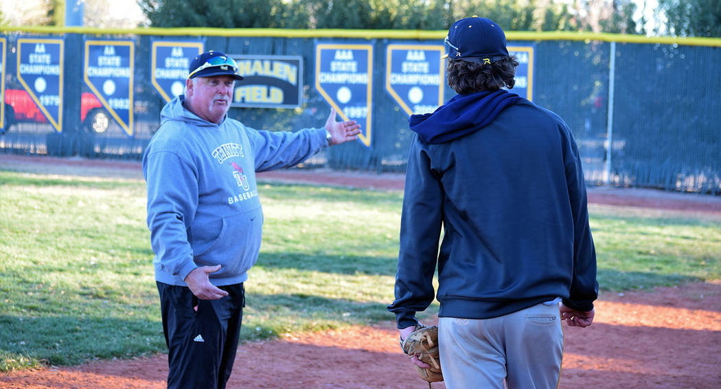 Boulder City High's first-year varsity baseball coach Ed McCann, seen instructing pitcher Shaun Jones during a practice session before the season started, was named 3A coach of the year. He also w ...