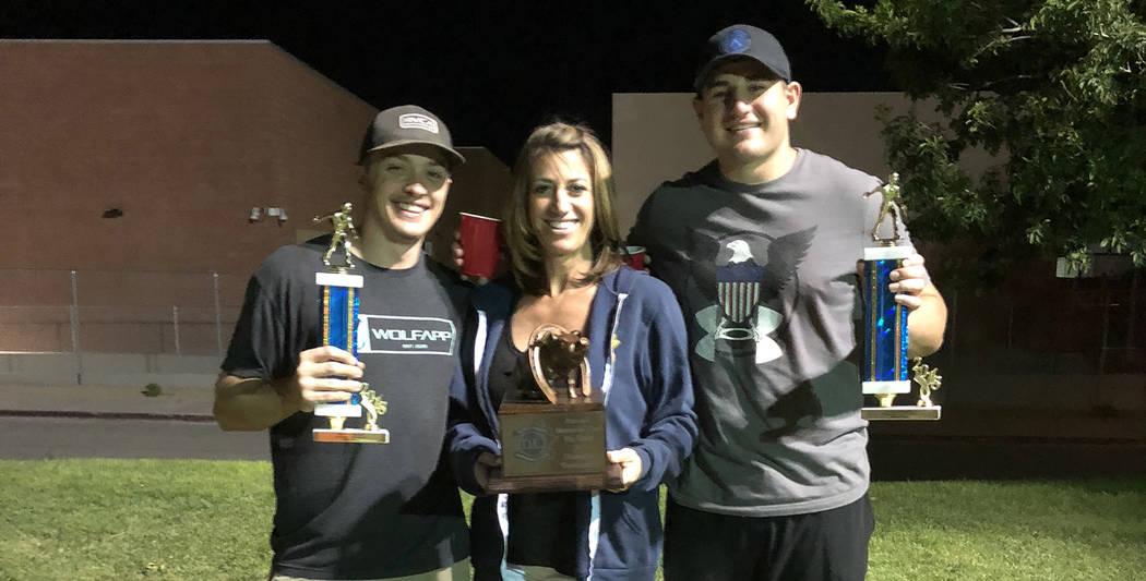 Dan Leach Memorial Fund Laura Leach, center, congratulates Abrey Wrightsman, left, and TJ Hatfield who won the 2018 Dan Leach Memorial Horseshoe Tournament played Memorial Day weekend. The event r ...