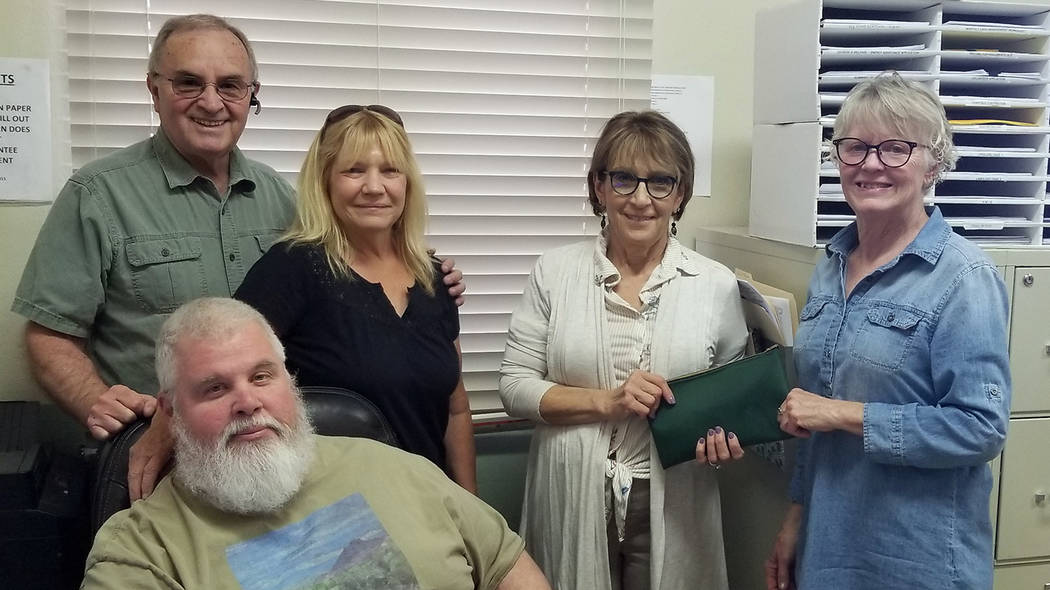 Emergency Aid of Boulder City Kathleen Wall, far right, recently presented a $1,300 donation to Emergency Aid of Boulder City. She offers a yoga class on Mondays at the Elaine K. Smith Center, wit ...