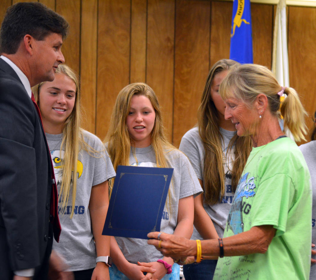 Celia Shortt Goodyear/Boulder City Review Mayor Rod Woodbury presents Boulder City High School Swim Coach Sara Carroll with a certificate of achievement at the City Council meeting Tuesday for the ...
