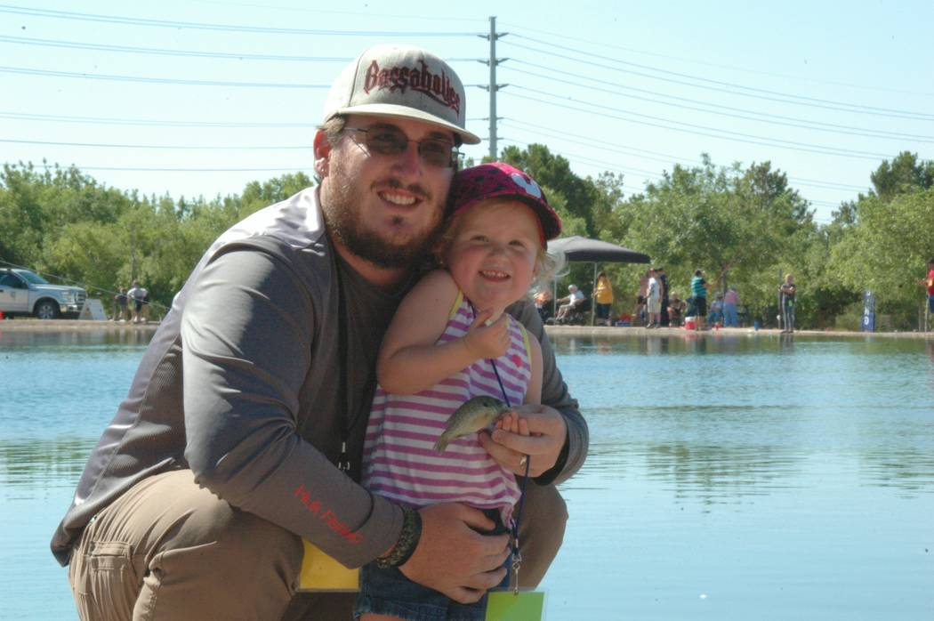 Jayme Sileo/Boulder City Review Free Fishing Day, marked Saturday at Veterans' Memorial Park, was successful for Ala Echler, who caught her first fish ever with a little help from her father, Cody ...