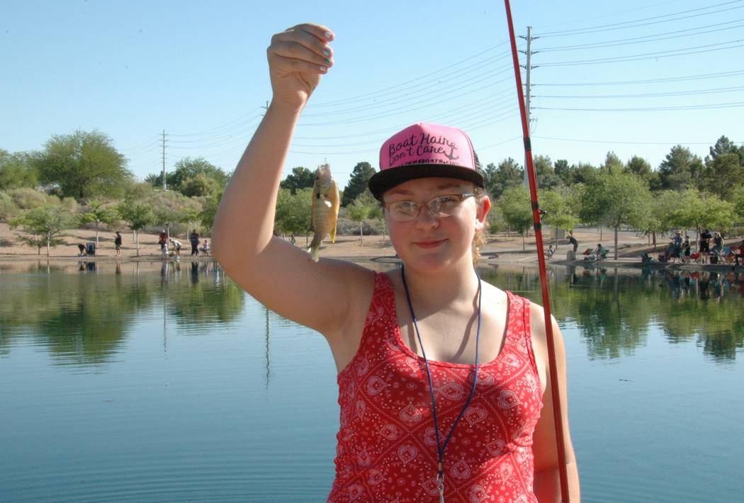 Jayme Sileo/Boulder City Review Lucy Finkel and her second fish of the day, a sunfish. She was among the dozens of families that came to Veterans' Memorial Park on Saturday for Free Fishing Day.