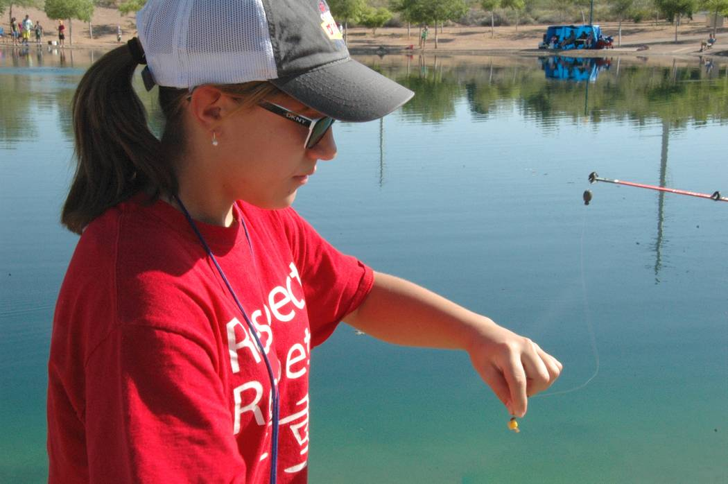 Jayme Sileo/Boulder City Review Jocallyn Piekarczyk attached the bait, composed of meal worms and corn, onto a hook during Free Fishing Day at Veterans' Memorial Park.