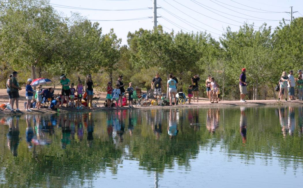 Jayme Sileo/Boulder City Review The cheers of families and amateur anglers catching their first fish sounded around Veterans' Memorial Park's pond during Free Fishing Day on Saturday.