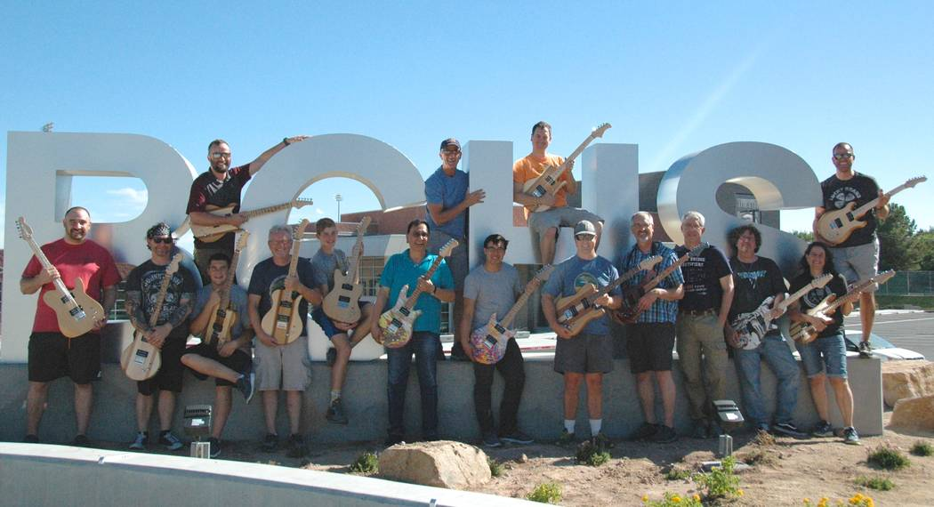 Jayme Sileo/Boulder City Review After finishing their electric guitars, members of the summer STEM Guitar institute, front row, from left, Ryan Capps, Jeff Hinton, Bret Stewart, Jim Berry, Jake Tr ...