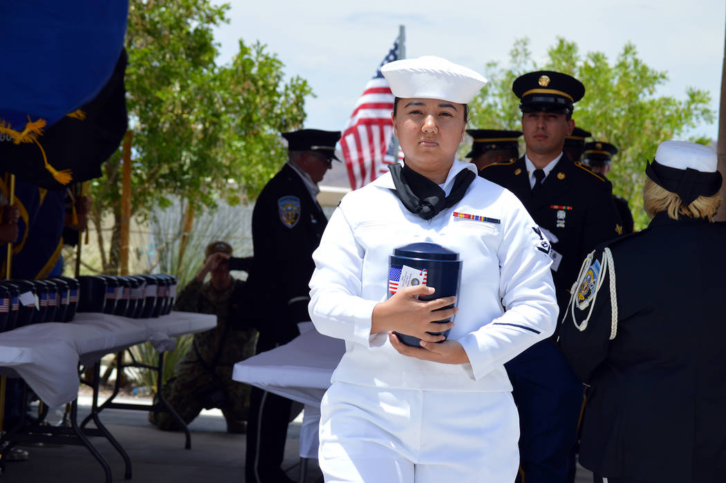 Celia Shortt Goodyear/Boulder City Review U.S. Navy Petty Officer 3rd Class Riceal Synnes carries the remains of Victor Forbush, who was a member of the U.S. Navy from 1926 to 1945 and fought in W ...