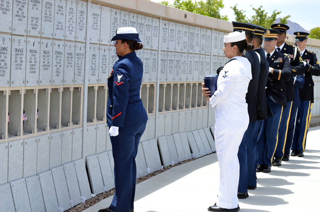 Celia Shortt Goodyear/Boulder City Review Members of the United States military carry the remains of 35 unclaimed veterans to their final resting places Friday at the Southern Nevada Veterans Ceme ...