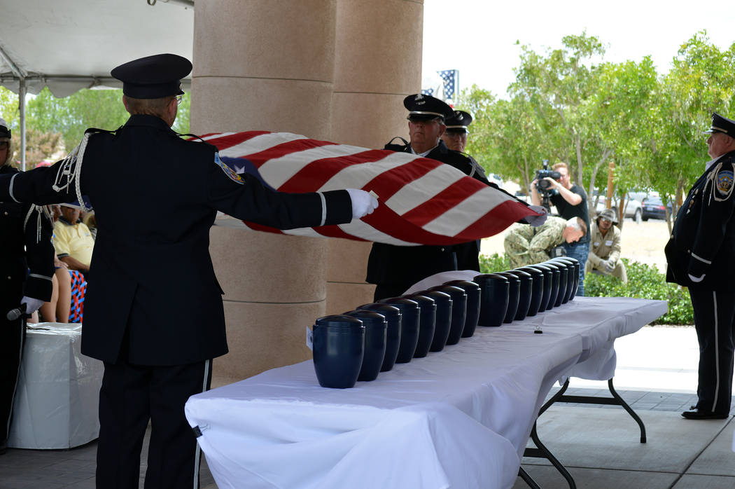 Celia Shortt Goodyear/Boulder City Review Members of the Nevada Veterans Coalition Honor Guard fold a United States flag at the unclaimed veterans ceremony Friday at the Southern Nevada Veterans M ...