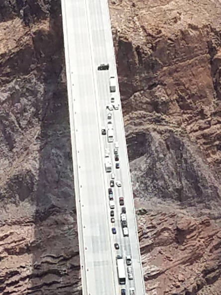 Arizona Department of Public Safety Matthew Wright of Henderson blocks the southbound lanes on the Mike O'Callaghan-Pat Tillman Bridge near the Hoover Dam on Friday.