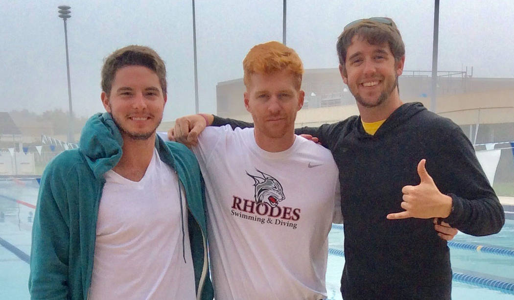 Drew Peterson Drew Peterson, a Boulder City High School graduate who was recently named assistant coach for Georgetown University's swim program, is seen with Charlie Boehme, center, and Brad Dunn ...