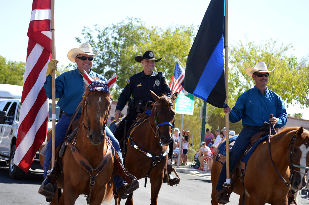 File Boulder City Police officer Scott Pastore, center, riding his horse, Odie, is joined by Evelio Rafael Sarabia, left, and Chris Jayne, members of the mounted posse that assists the department ...