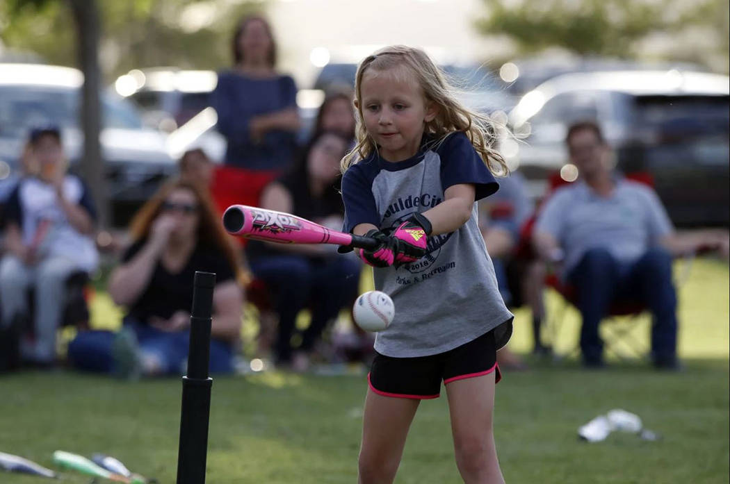 Canaan Petersen Harper Dosch swings during a recent T-ball game in the Boulder City Parks and Recreation Department's youth league.