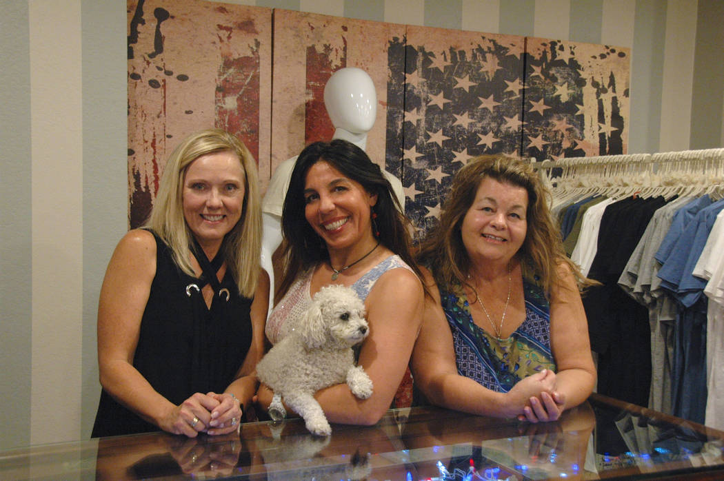 Jayme Sileo/Boulder City Review Lisa Wright, from left, Sonia Mongili and Kathleen Feeney are gearing up for COOL Boutique's anniversary party from 11 a.m. to 5 p.m. Saturday with help from the ...