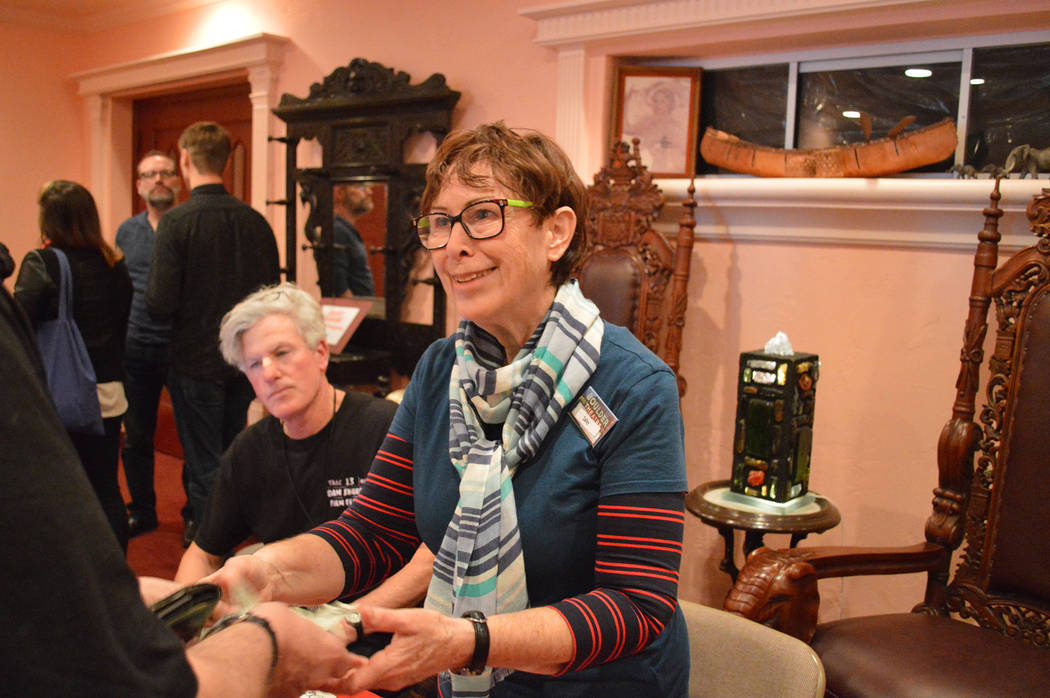 File Sally Sawyer of Henderson checks in attendees at the 13th annual Dam Short Film Festival in Boulder City in 2017. The Dam Short Film Society was recently awarded a $5,000 grant from Nevada Hu ...