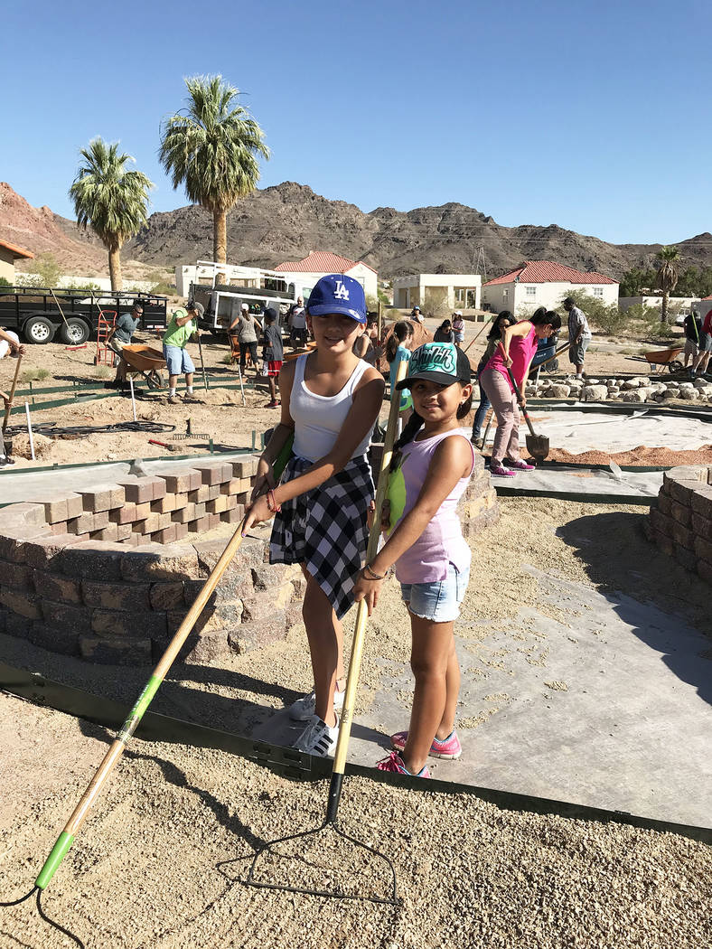 Hali Bernstein Saylor/Boulder City Review Volunteers of all ages, including Natielle, left, and Shylah Martinez of Las Vegas, came to St. Jude's Ranch for Children in Boulder City on Saturday to h ...