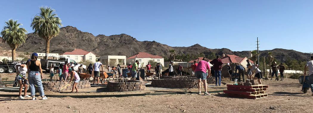 Hali Bernstein Saylor/Boulder City Review Volunteers gathered at St. Jude's Ranch for Children on Saturday to help build a community garden. The garden will serve as a gathering spot, as well as t ...