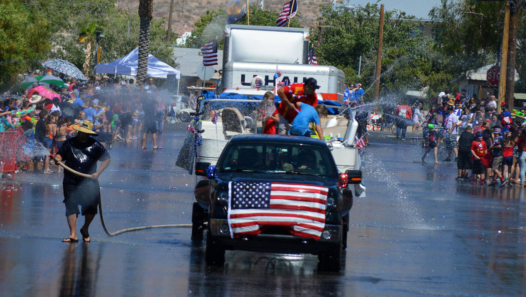 Celia Shortt Goodyear/Boulder City Review Participants and spectators of the 70th annual Damboree parade get soaking wet on Wednesday.