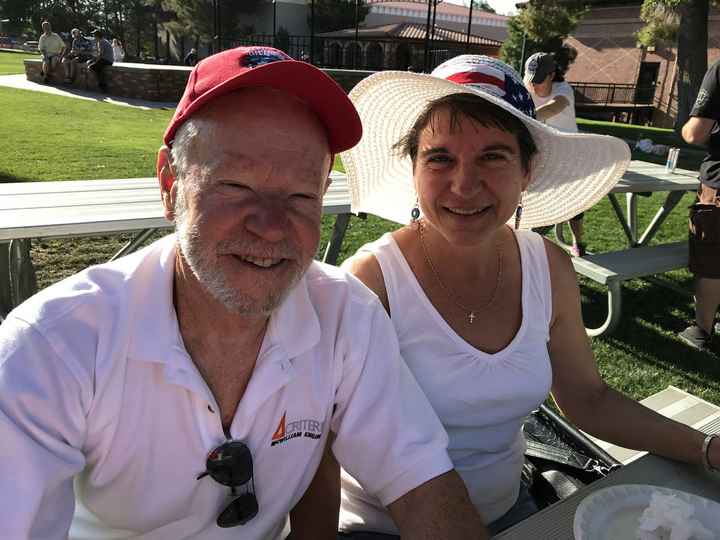 Hali Bernstein Saylor/Boulder City Review Boulder City residents Chay and Katie McWilliam came to Bicentennial Park early Wednesday, July 4, 2018, morning to enjoy a pancake breakfast served by th ...