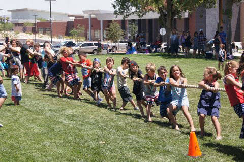 Roger Hall Children give their all in the tug-o-war contest that was part of the Damboree festivities in Broadbent Park on July 4.