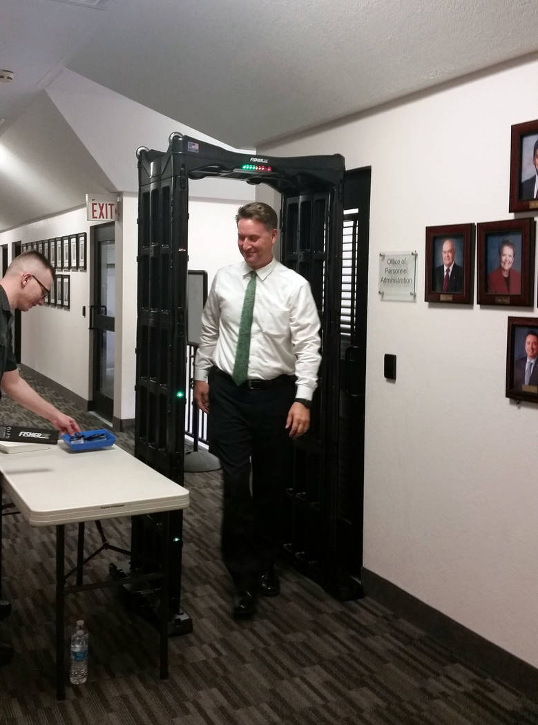 Celia Shortt Goodyear/Boulder City Review City Attorney Steve Morris goes through a metal detector at City Hall before the City Council meeting Tuesday. The metal detectors are a new security meas ...