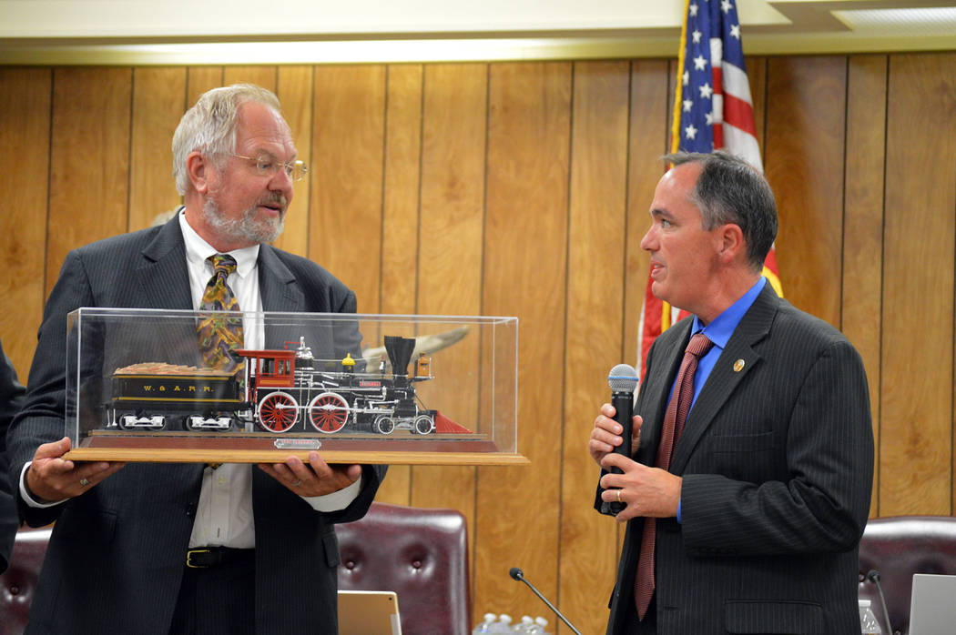 Celia Shortt Goodyear/Boulder City Review Celia Shortt Goodyear/Boulder City Review Community Development Director Michael Mays, right, presents Randy Hees, director of the Nevada State Railroad ...