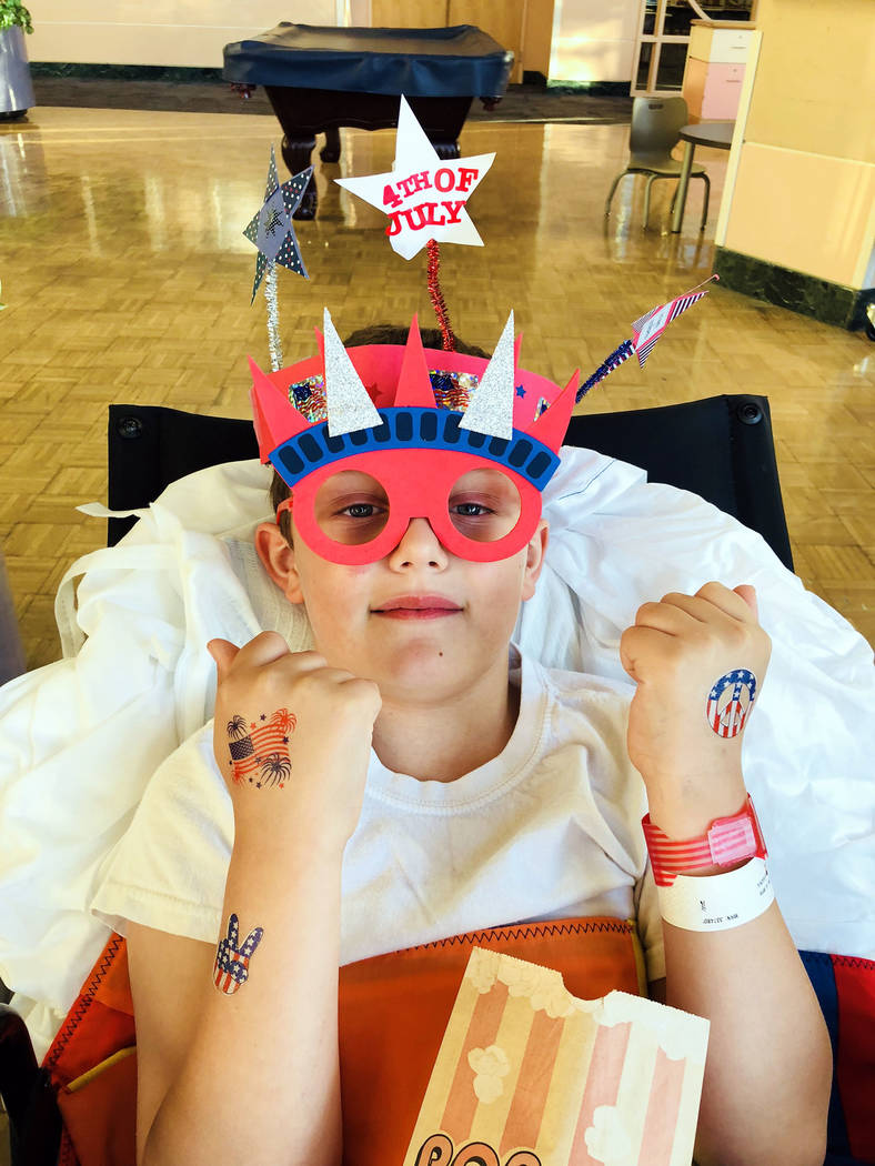 Tara Bertoli T.J. Bertoli celebrates the Fourth of July at the Shriners Hospital for Children in Sacramento where he had surgery to heal his hip due to damage from Legg-Calve-Perthes disease.