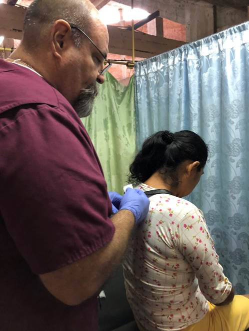 Larry Smith Dr. Larry Smith of Boulder City prepares to give a woman an injection that will help relieve her pain during a recent trip to Ecuador as part of Healing Hands Abroad.