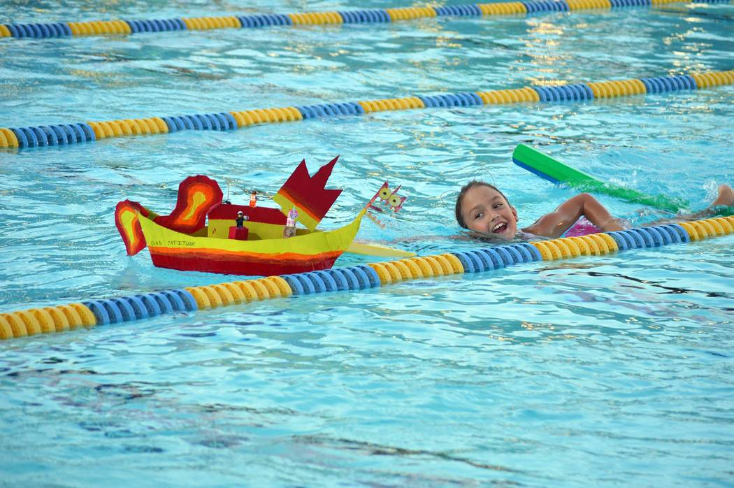 "File Last year's Mayor's Choice award winner, Jenny Freshour, pushes her boat, ""Bad Cattitude,"" in 17th annual cardboard boat race at the Boulder City Pool."