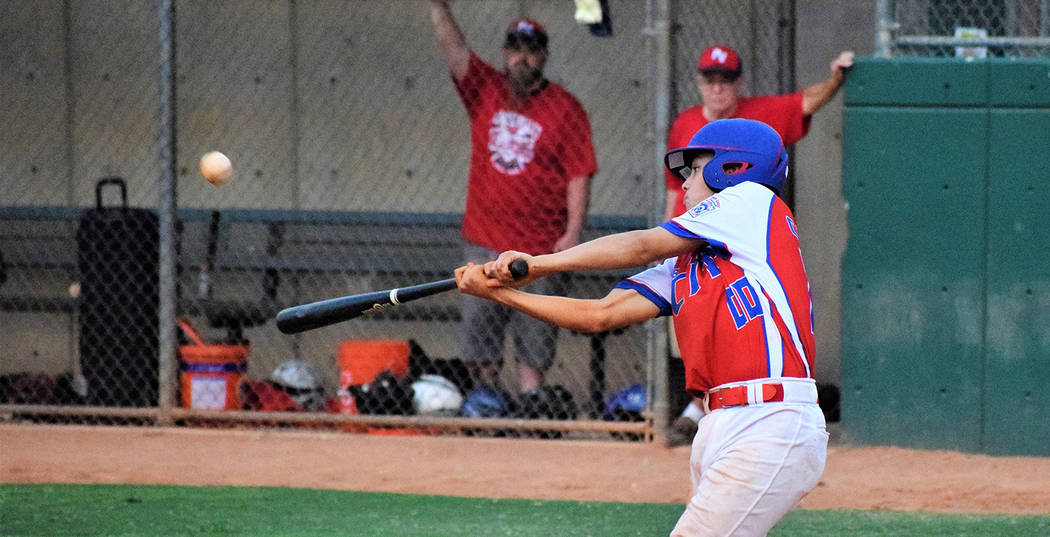 Robert Vendettoli/Boulder City Review Chase Calvez of the Boulder City Little League Junior All-Stars lines a shot to left field against the Henderson All-Stars on July 12, 2018, in the District I ...