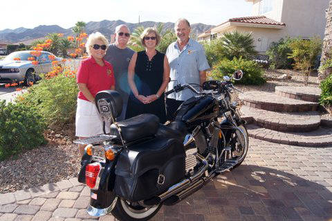 Roger Hall Tony and Carolyn Veirup, center, donated a 1999 Victory motorcycle for Boulder City Sunrise Rotary's WurstFest live auction, which will be held Sept. 29. Accepting on behalf of the cl ...