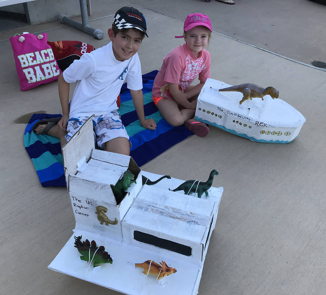 Hali Bernstein Saylor/Boulder City Review Sammy Schultz, 10, created the US Raptor Carrier and his sister, Mieke Schultz, 6, made the Dinosaur Rex for the 18th annual cardboard boat races at the B ...