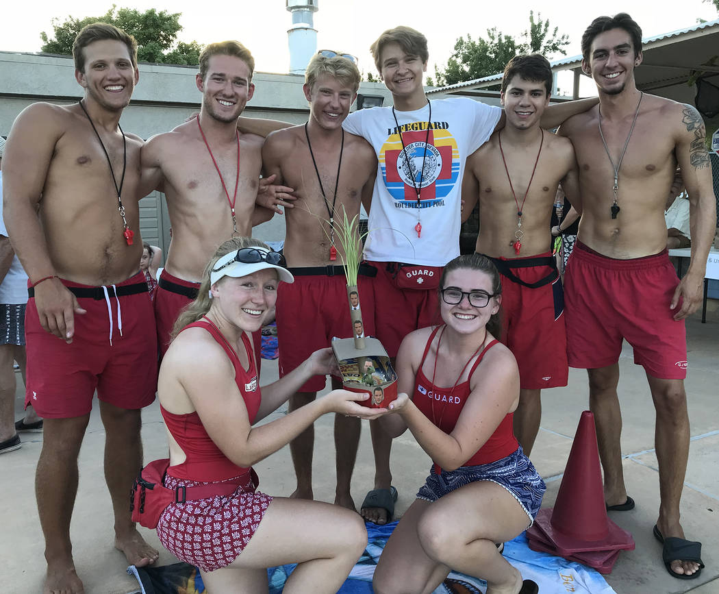 Hali Bernstein Saylor/Boulder City Review For the first time in the history of the cardboard boat races at Boulder City Pool, its lifeguards had an entry. Showing off their creation are, standing, ...