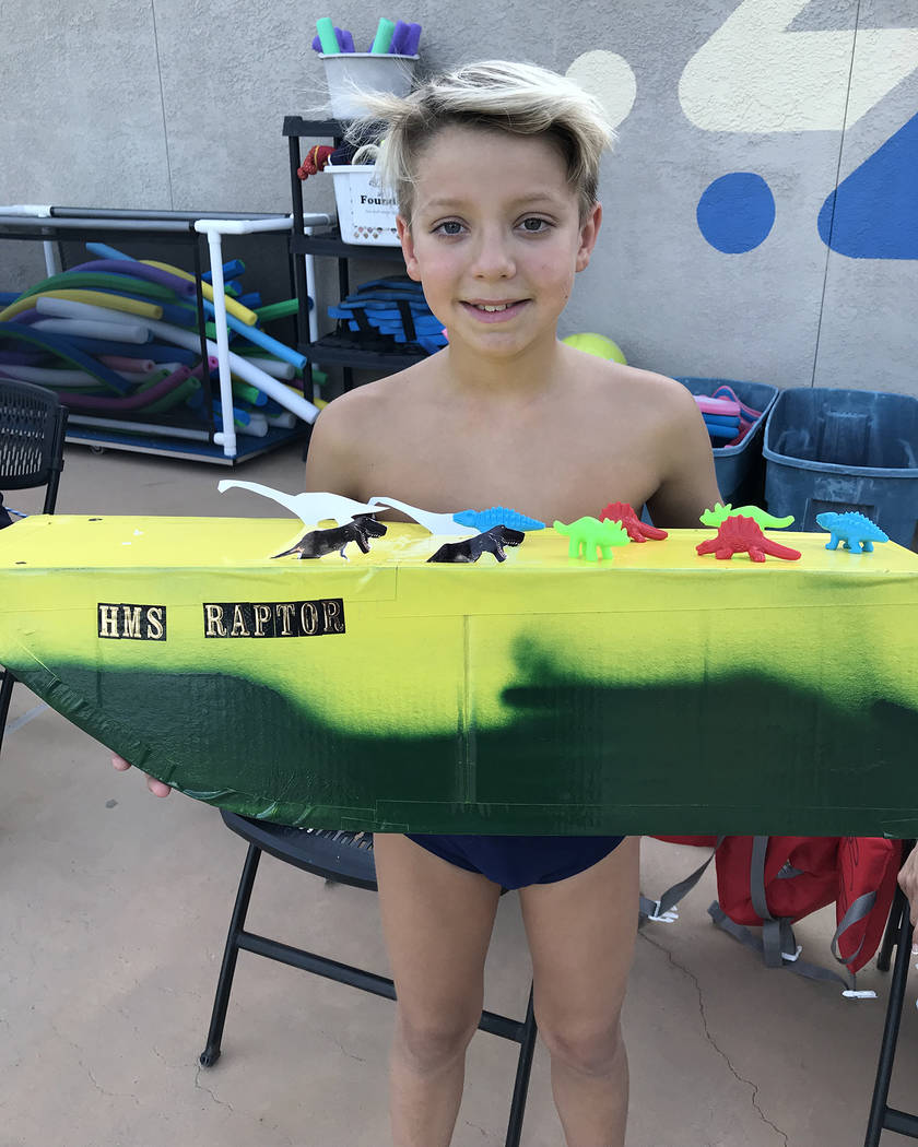Hali Bernstein Saylor/Boulder City Review Canyon Lenon, 10, entered the HMS Raptor in the 18th annual cardboard boat races at Boulder City Pool on July 25. His boat came in second place in the mos ...