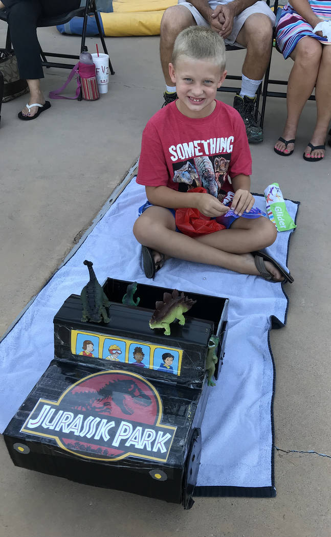 Hali Bernstein Saylor/Boulder City Review Carson Conway, 7, shows off his Jurassic Jeep entry for the 18th annual cardboard boat races at the Boulder City Pool on July 25. It won third place for m ...